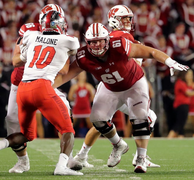 Wisconsin offensive lineman Tyler Biadasz  provides pass protection.