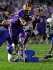 New Berlin's Jack Himmelspach fights through a tackle on his way to a touchdown.