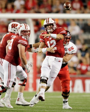 Wisconsin Badgers quarterback Alex Hornibrook (12) throws under pressure in the second quarter against the Western Kentucky Hilltoppers of an NCAA football game at Camp Randall on Friday, August 31, 2018 in Madison, Wis. Adam Wesley/USA TODAY NETWORK-Wis