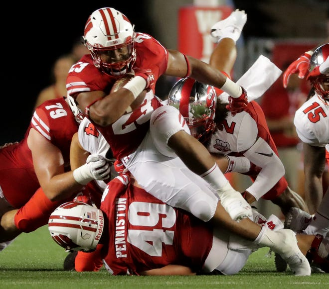 Wisconsin running back Jonathan Taylor  finds a seam in the Western Kentucky defense.
