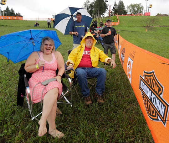 Janna Grosse and her husband, Gary, of  Hartford, enjoy watching the Harley-Davidson hill climb.