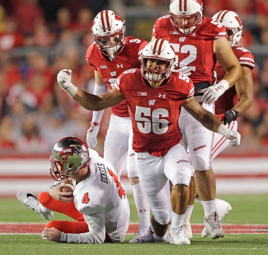 Wisconsin Badgers linebacker Zack Baun sacks Western Kentucky Hilltoppers quarterback Drew Eckels.