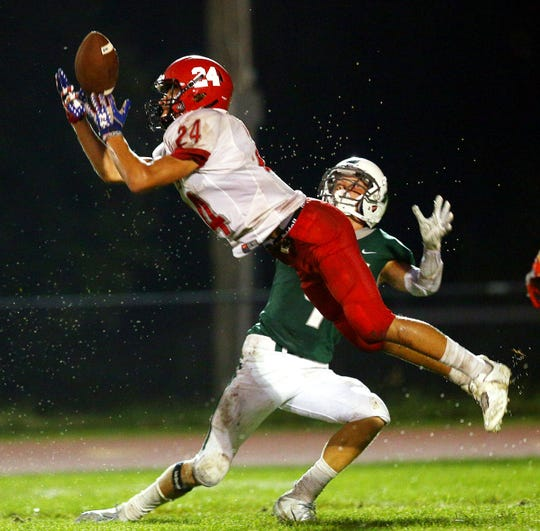 Parsippany's Anthony Colasuonno pulls in an interception on the last play of the first half intended for Kinnelon receiver Reilly Nelson during their SFC American Blue football season opener. August 31, 2018, Kinnelon, NJ