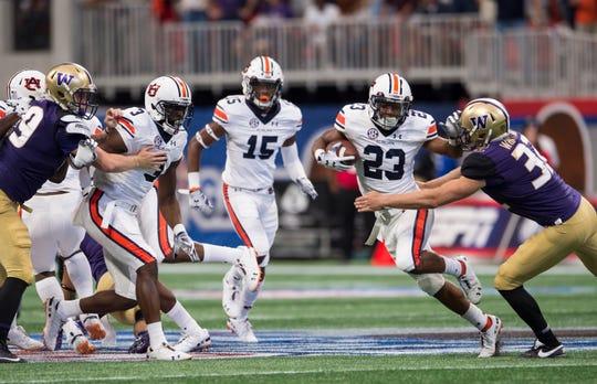Auburn's Ryan Davis (23) breaks off a big punt return against Washington at Mercedes-Benz Stadium in Atlanta, Ga., on Saturday, Sept. 1, 2018. Auburn leads Washington 15-13 at halftime.