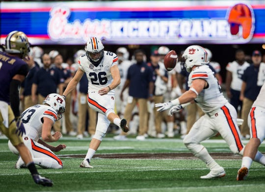 Auburn's Anders Carlson (26) kicks a field goal in the first quarter at Mercedes-Benz Stadium in Atlanta, Ga., on Saturday, Sept. 1, 2018. Auburn defeated Washington 21-16 in the Chick-fil-a Kickoff Game.