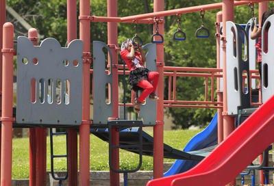 A child plays on playground equipment.