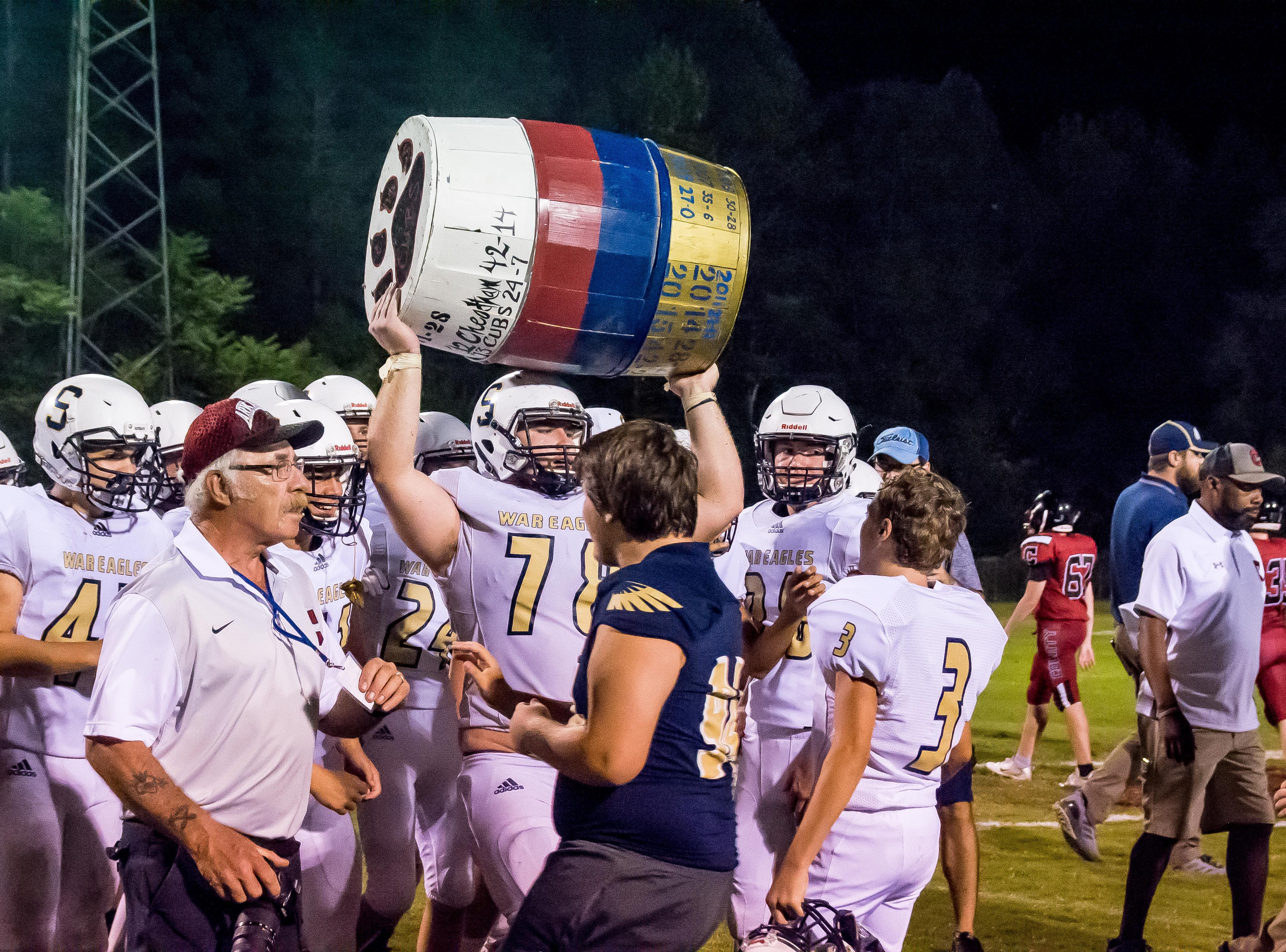 Zachary Sullivan grabs the powder keg after Sycamore defeated Cheatham County.
