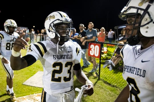 Springfield's Dayron Johnson (23) laughs with a teammate during Springfield's game against White House Heritage at White House Heritage High School in White House on Friday, Aug. 31, 2018.
