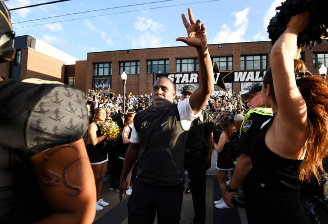 Vanderbilt head coach Derek Mason waves to fans during Star Walk on the way to Vanderbilt Stadium Saturday, Sept. 1, 2018, in Nashville, Tenn.
