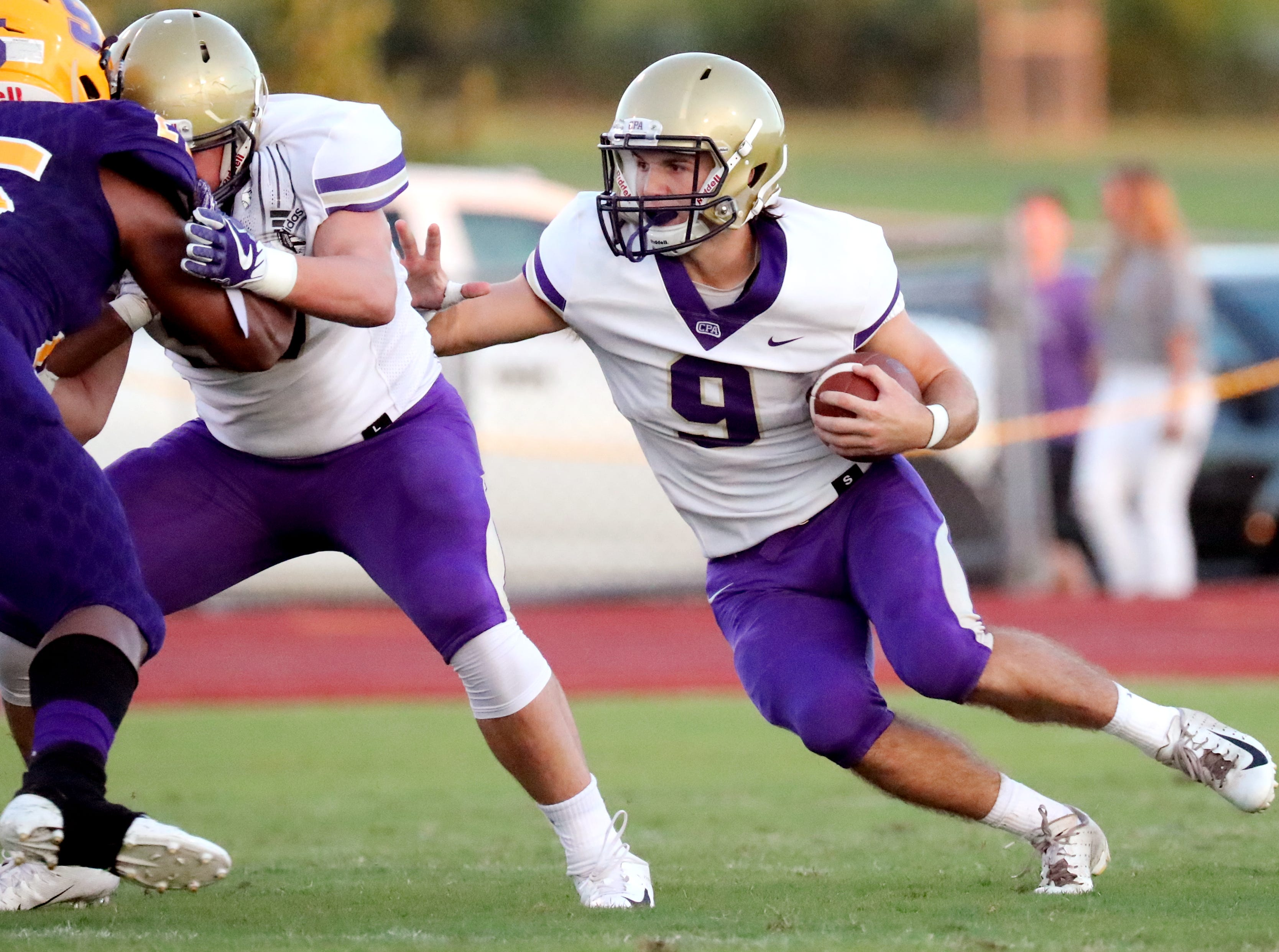 CPA's Sam West (9) runs the ball during game against Smyrna at Smyrna High School on Friday, Aug. 31, 2018.
