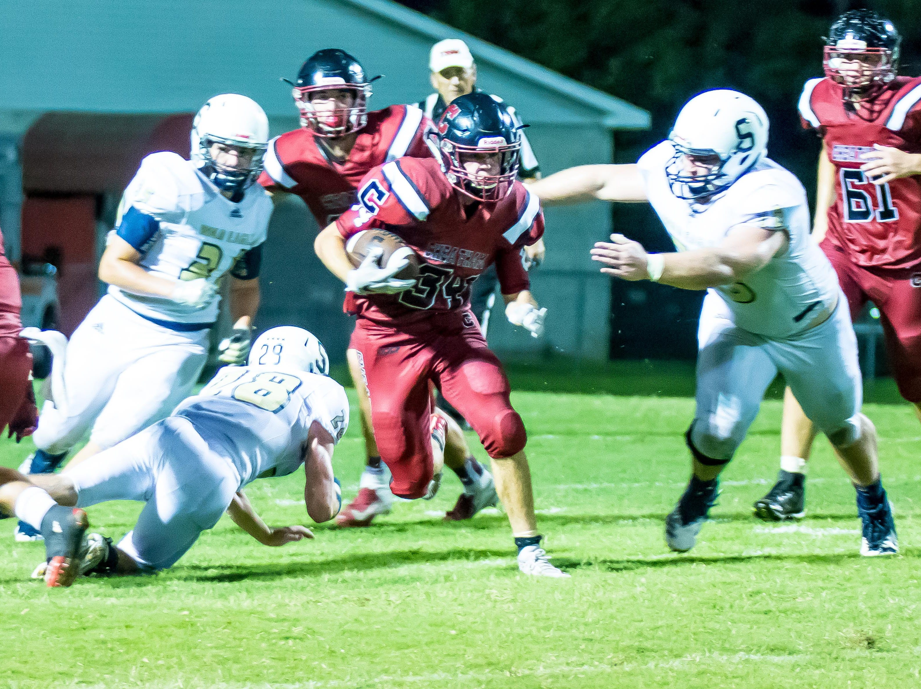 Cheatham County's Walker Bunce runs the ball against rival Sycamore.