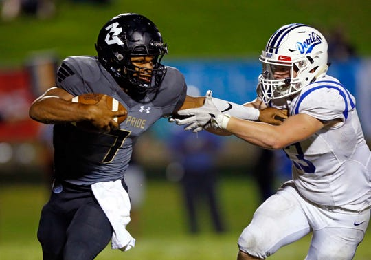 Mt. Juliet's Alvin Mixon (7) stiff arms Lebanon's Kholby Salerno as he runs for yardage during their game Friday, Aug. 31, 2018, in Mt. Juliet, Tenn.