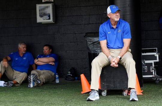Middle Tennessee head coach Rick Stockstill waits out the weather delay before the game at Vanderbilt Stadium Saturday, Sept. 1, 2018, in Nashville, Tenn.