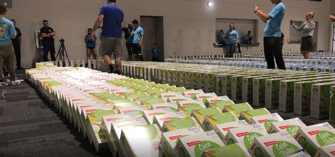 A Guinness world record was unofficially broken as 3,913 cereal boxes were toppled over like dominoes inside Grow Church in North Naples Saturday, Sept. 1, 2018.