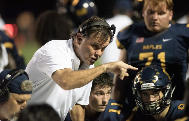 Naples head coach Bill Kramer yells at his players after Miami-Palmetto got out to a quick lead in the game at Naples High Friday night, August 31, 2018.