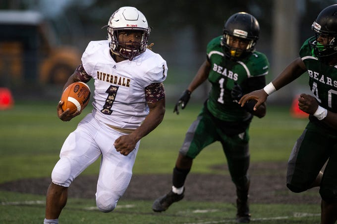 Riverdale's Quantavius Brown runs the ball back during a game against Palmetto Ridge High School in Naples, Fla. on Friday, Aug. 31, 2018.