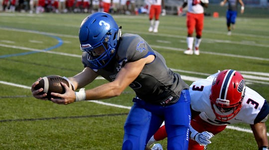 Barron Collier High School running back Drew Powell (3) reaches for the goal line during their game with Superior Collegiate in Naples, Friday, Aug. 31, 2018.