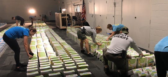 A Guinness world record was unofficially broken as 3,913 boxes of cereal were toppled over like dominoes inside of Grow Church in North Naples Saturday.