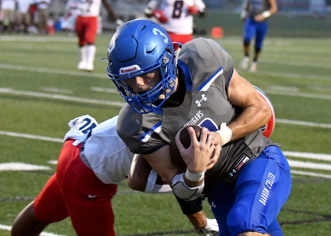 Barron Collier High School running back Drew Powell (3) runs the ball during their game with Superior Collegiate in Naples, Friday, Aug. 31, 2018.