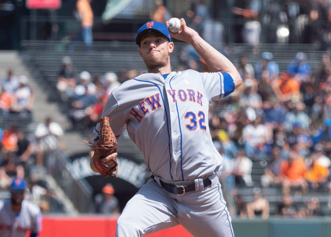 New York Mets starting pitcher Steven Matz (32) delivers a pitch to the San Francisco Giants during the first inning at AT&T Park.