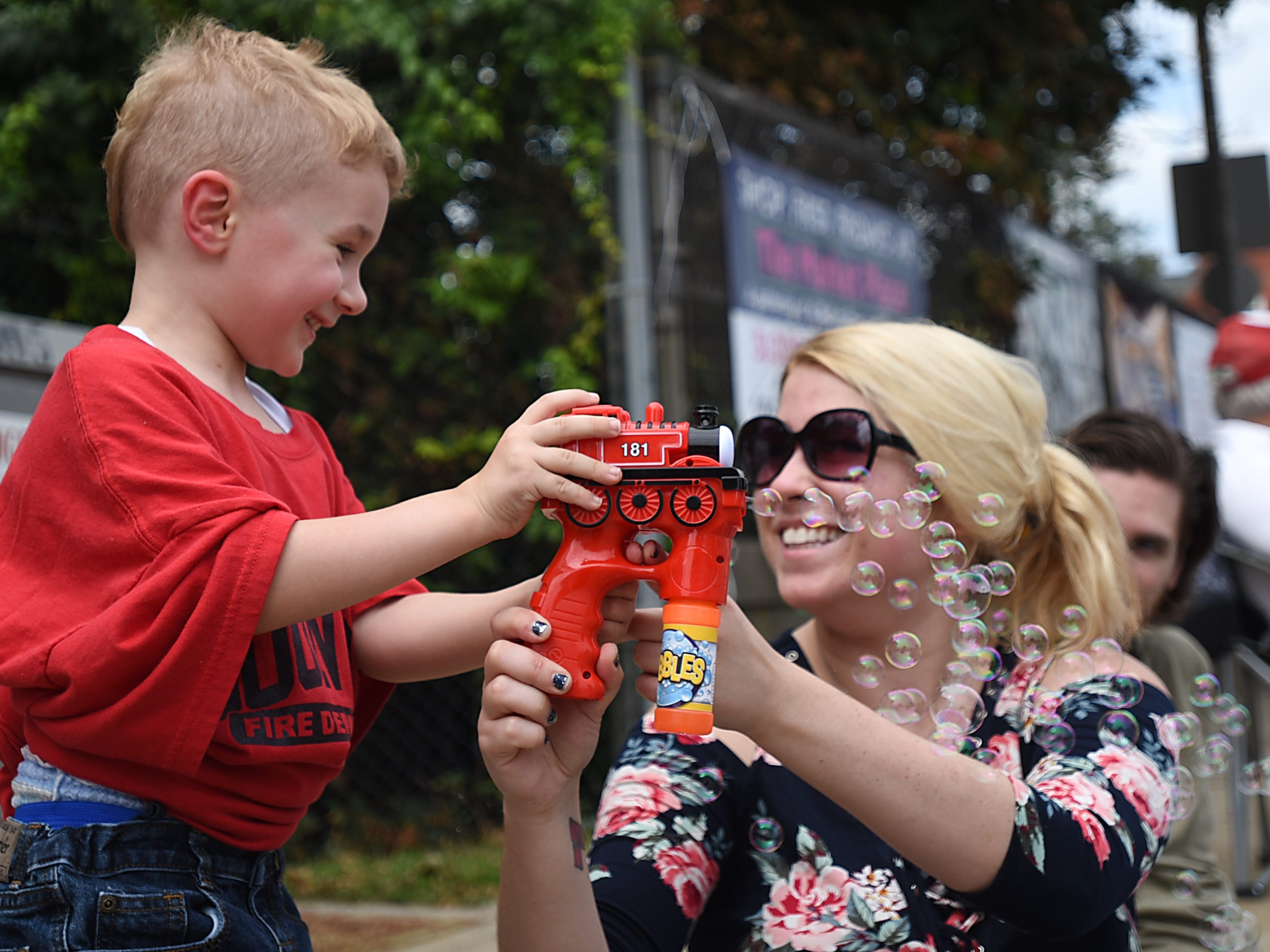 Charlie Sedlak three years old from Boonton, blows bubbles with Michelle Franchino from Parsippany during the Boonton parade in Boonton on Saturday September 1, 2018.