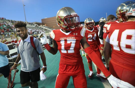 Amar Gist, of Bergen Catholic, celebrates on the sideline as the final seconds click off the clock in the fourth quarter in Buford, GA. Friday, August 31, 2018