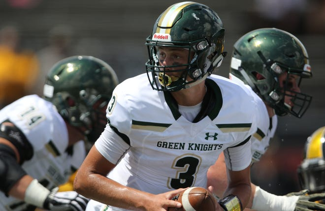 Michael Alaimo, of St. Joseph Regional, looks to hand-off the ball during the first half in Milton, Georgia. Saturday, September 1, 2018