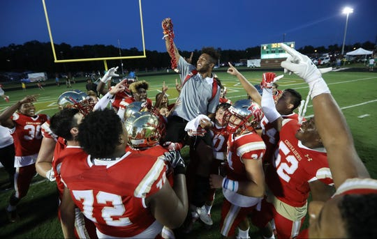 Injured Crusader, Josh McKenzie is lifted into the air by his Bergen Catholic teammates after they won in Georgia.  McKenzie gave an emotional speach to his teammates just before the start of the game. Friday, August 31, 2018