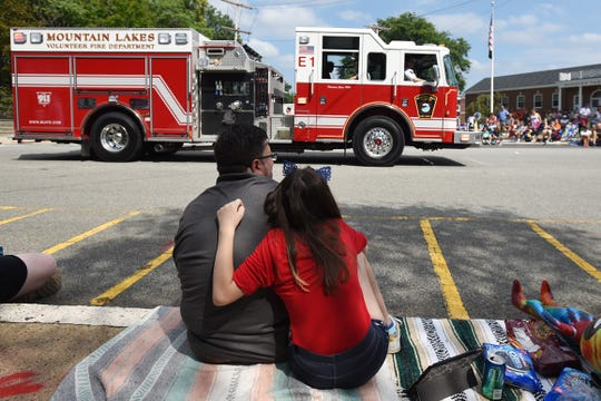 Michael DeLuca and Catherine DeLuca, both from Netcong, watch the Boonton parade in Boonton on Saturday September 1, 2018.