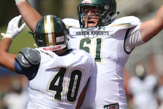 Jake Yoffee (61) and Justin Malvasia, of St. Joseph Regional, celebrates a second half touchdown in Milton, Georgia. Saturday, September 1, 2018