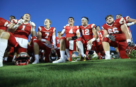 Bergen Catholic as they wear smiles of victory in Georgia. Friday, August 31, 2018