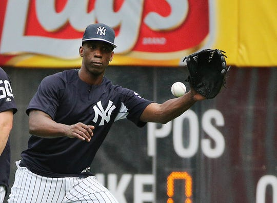 Newly acquired New York Yankees outfielder Andrew McCutchen (26) warms up in the outfield during batting practice prior to the game against the Detroit Tigers at Yankee Stadium.