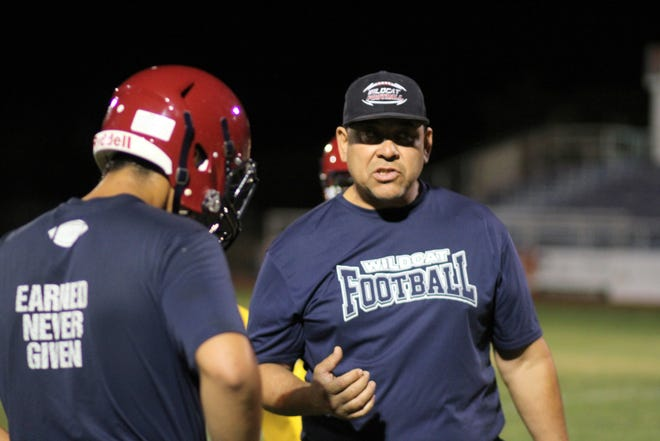Deming High assistant coach Richard Perales had the Wildcat linemen in top form in holding the high-scoring Capital Jaguars in a 14-all tie Friday night in Santa Fe.