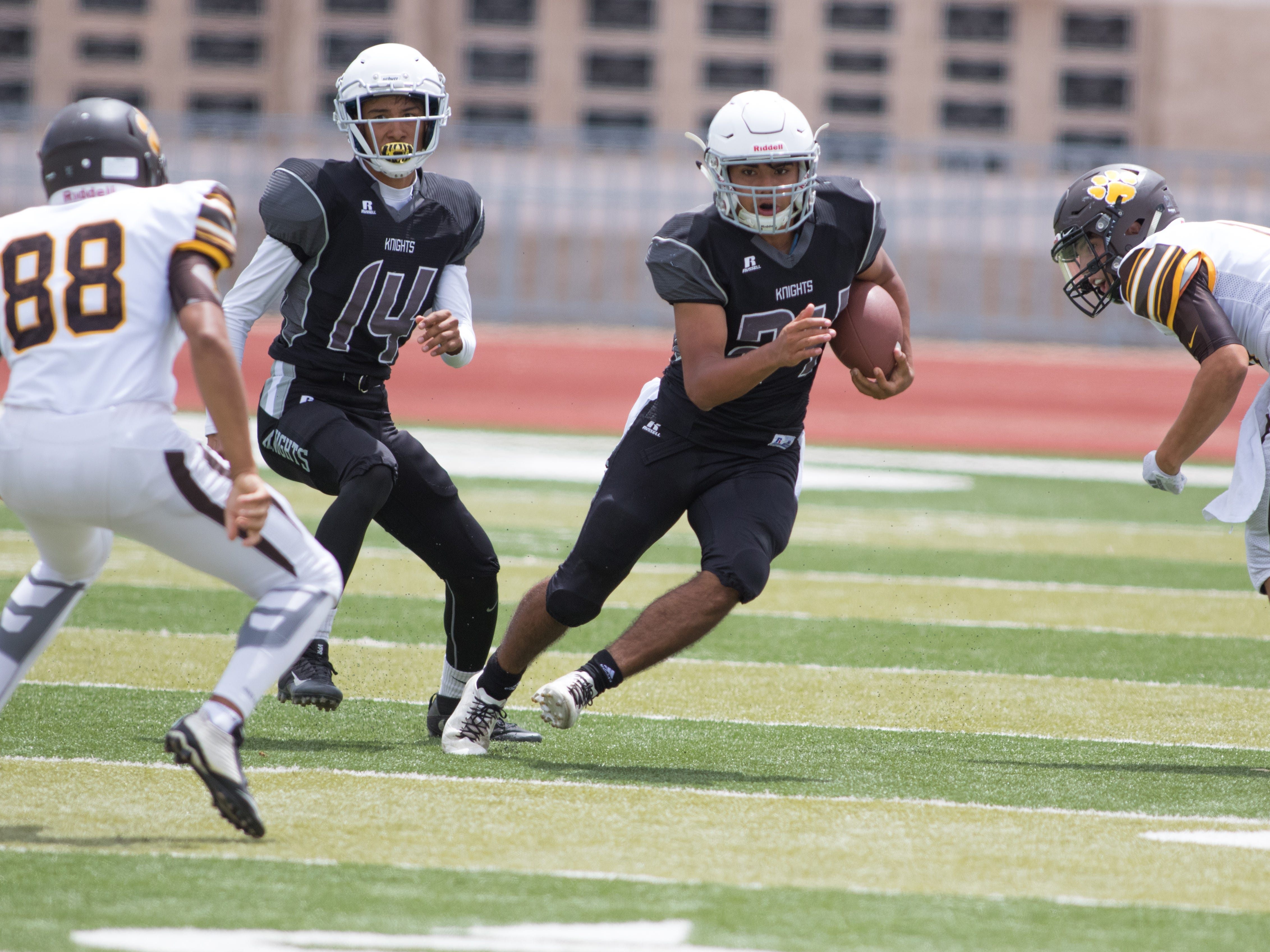 Oñate running back Nasiem Al-Abayad cuts through the Cibola defense on Friday at the Field of Dreams.