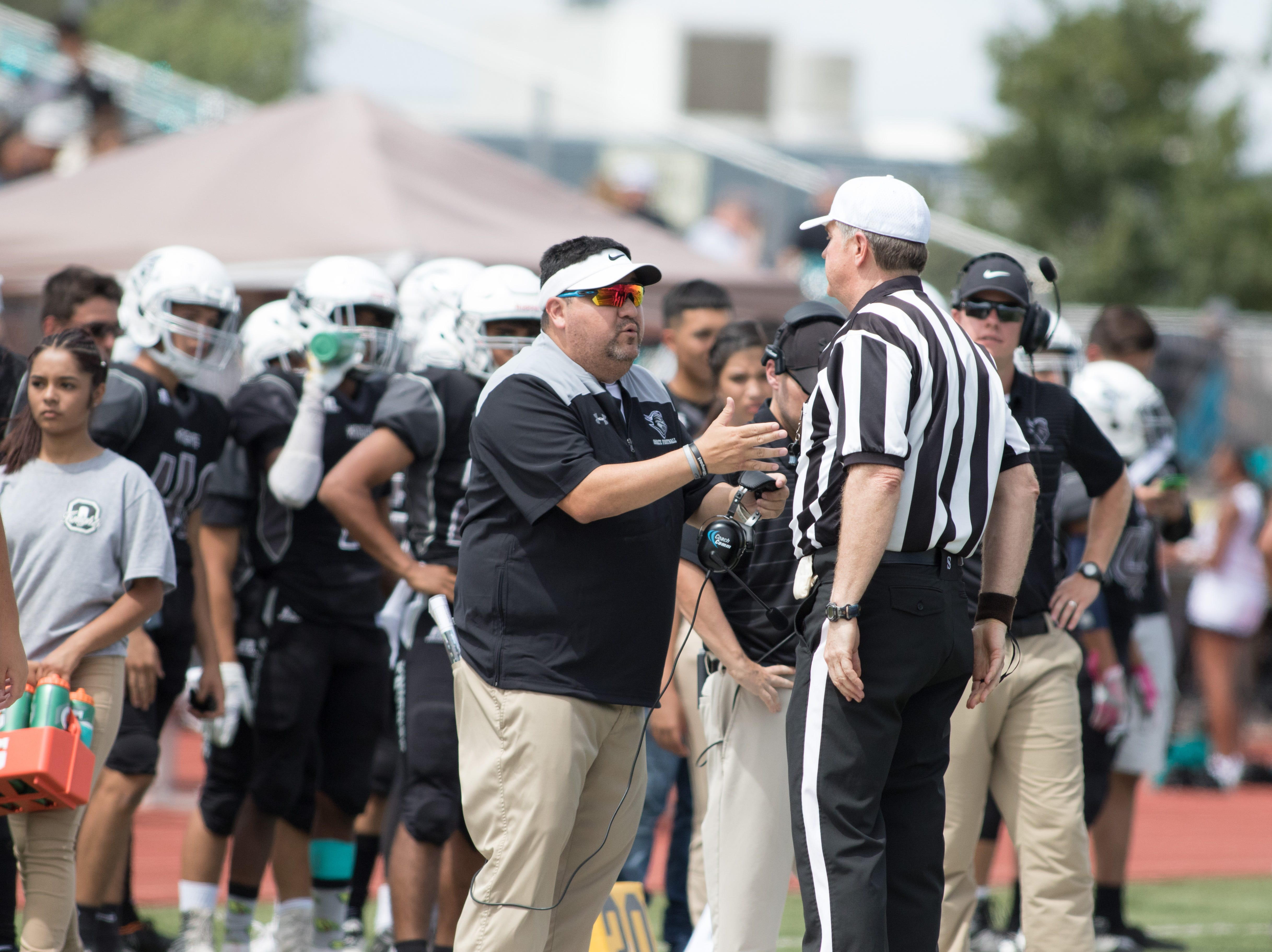 Onate head coach Scott Veliz seeks clarification after a flag during the boys prep football game against Cibola on September 1, 2018.