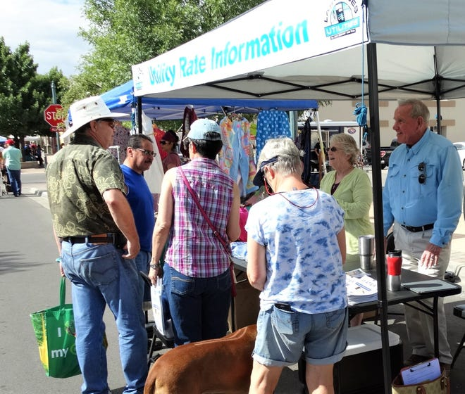 During the recent water rate review, UCAG committee members spoke to citizens at the Farmer's Market. Through open houses and this type of presentation, citizens have a chance to ask more questions one-on-one.