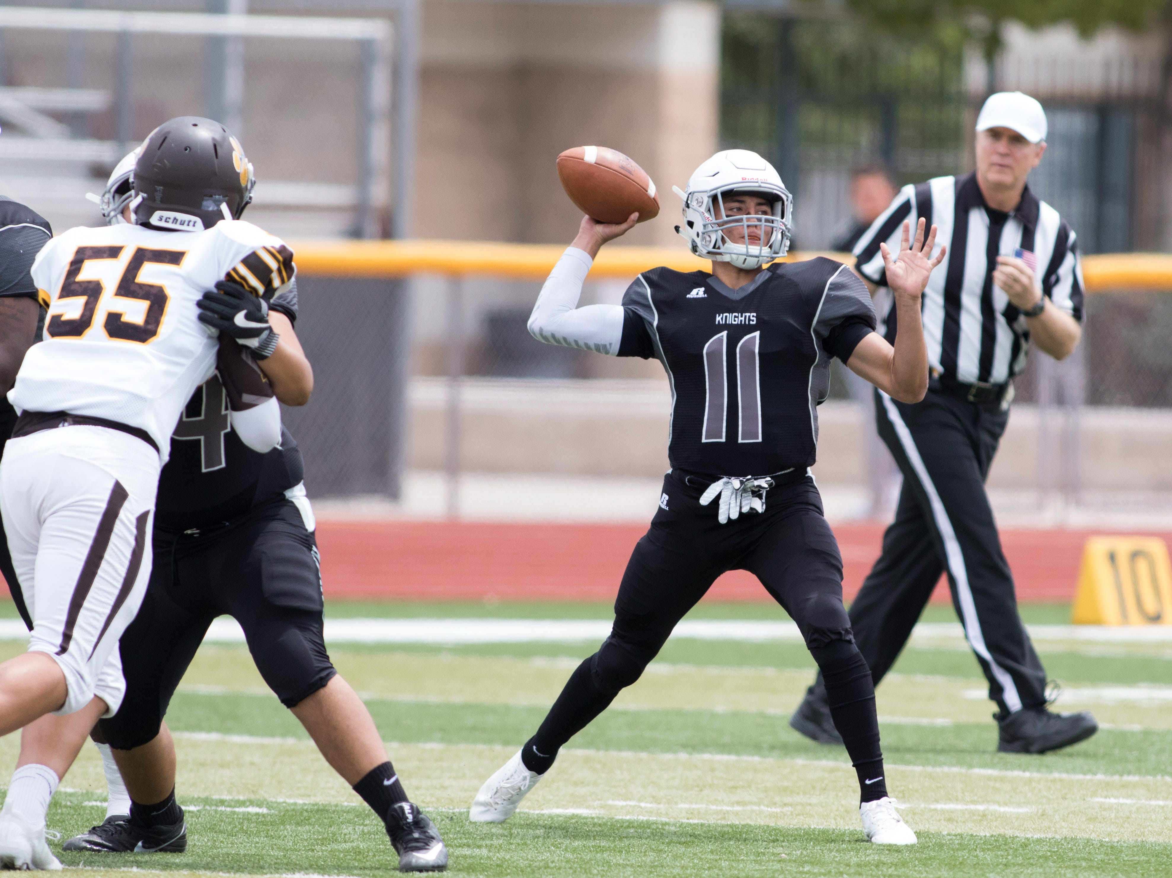 Onate Knight quarterback Jayden Diaz looks downfield to fire a pass during boys prep football against Cibola on September 1, 2018.