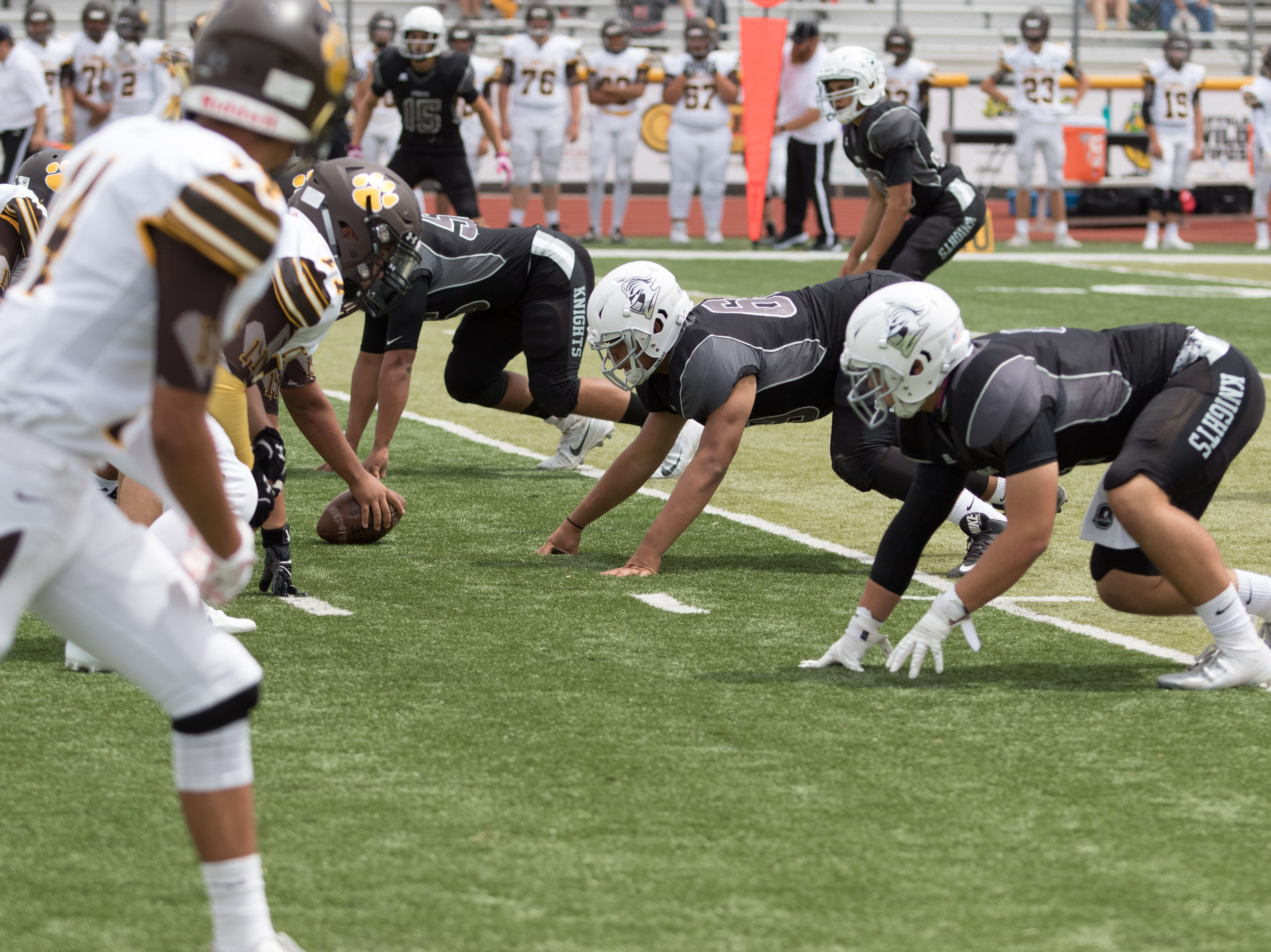 The Onate defense gets set for the hiked ball during boys prep football game against Cibola on September 1, 2018.