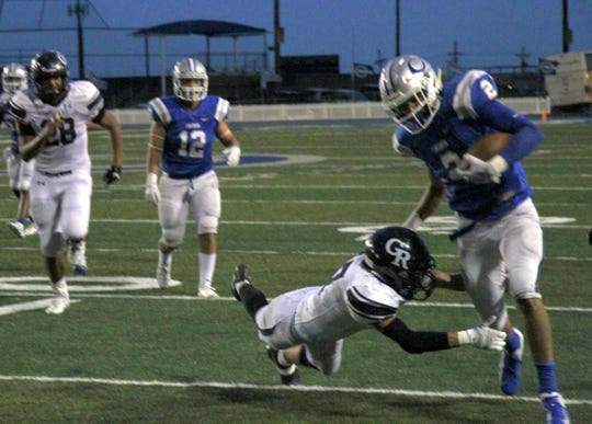 Tate Collins breaks a Goddard tackle late in the second quarter of Friday's game.