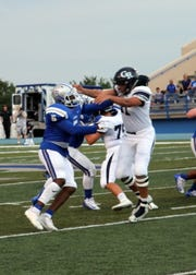 Shamar Smith (5) tries to get around Goddard tackle Larry Luna in the first quarter of Friday's game.