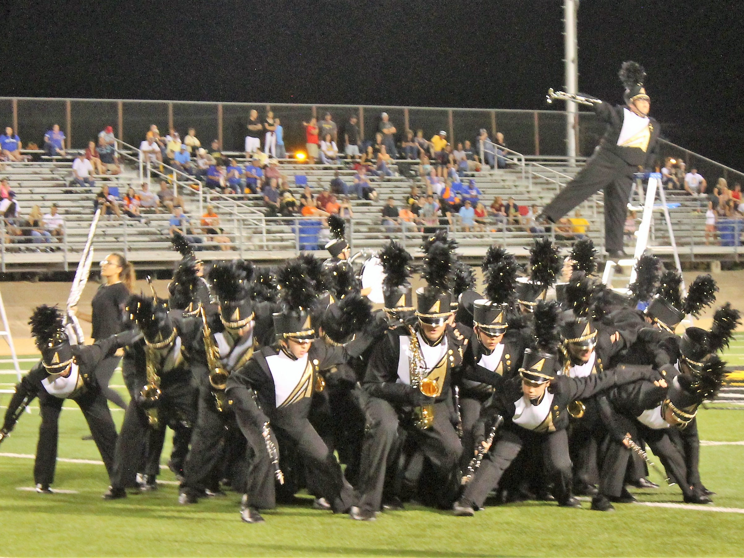 The Alamogordo Tiger Marching Band performs their marching show War Dance during halftime at Friday night's game against Los Lunas.