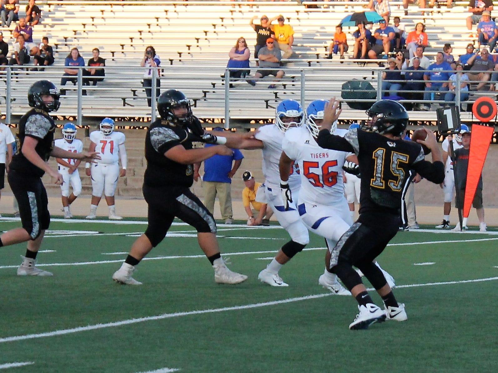 Alamogordo Tigers quarterback Bradon Martin prepares to throw the ball at Friday night's game against Los Lunas.