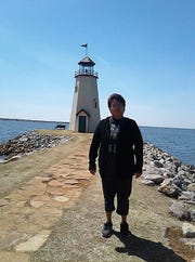 Sadie Thomasstands outside an Oklahoma lighthouse in this undated photo. Family members believe Sadie is one of eight people who died in Thursday's Greyhound bus crash near Thoreau.