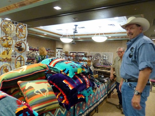 Blankets and decorative pillows were popular with shoppers along with spurs, knives and wind ornaments.