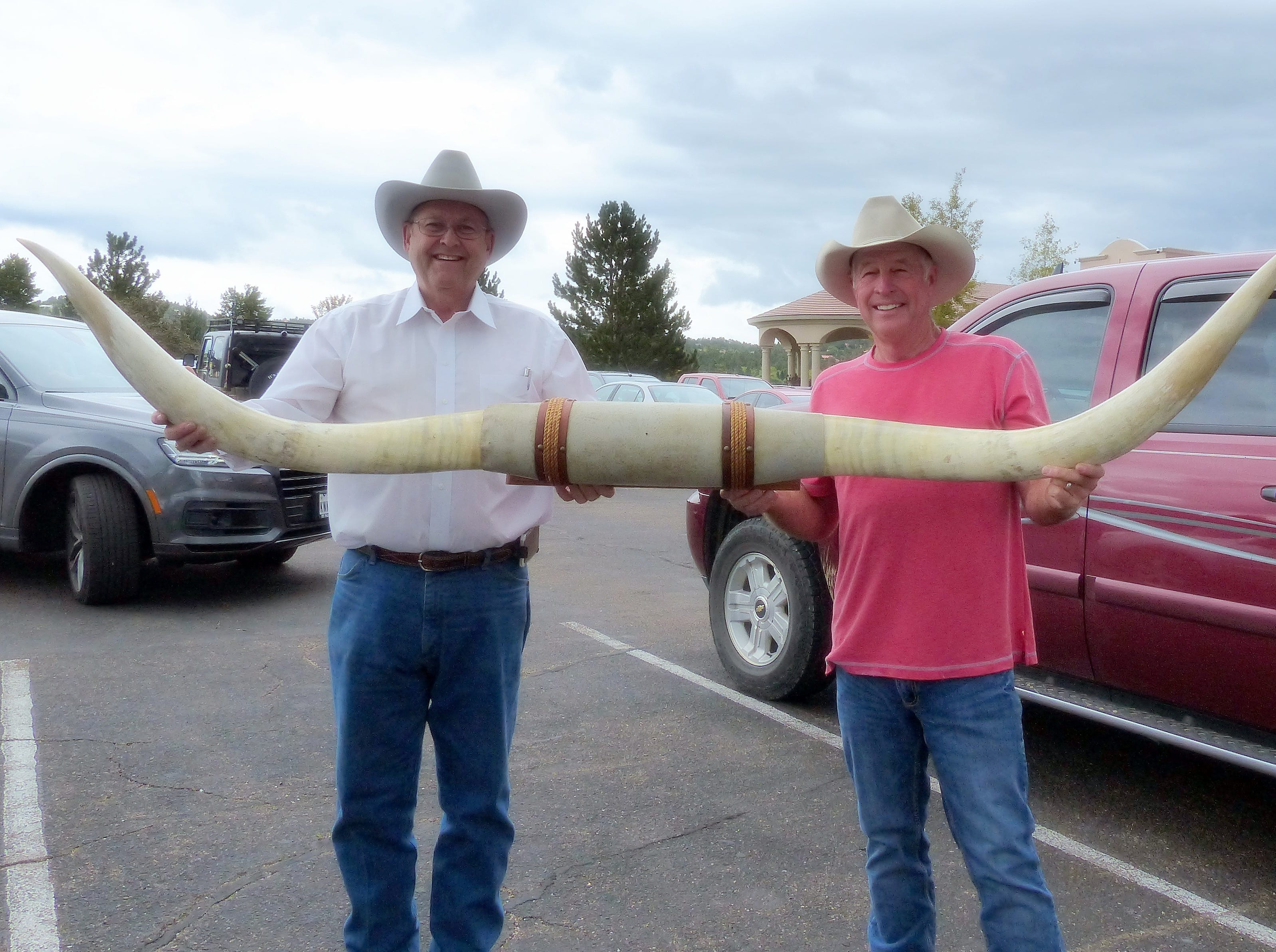 Randy Hutto of Dripping Springs, Texas, left, and Gary Simon from Joppa, Texas are going home with a mighty big collectible,