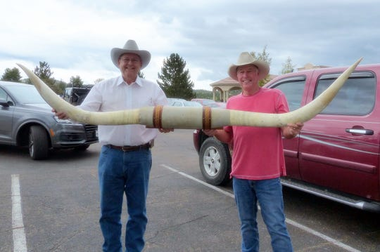 Randy Hutto of Dripping Springs, Texas, left, and Gary Simon from Joppa, Texas are going home with a mighty big collectible.