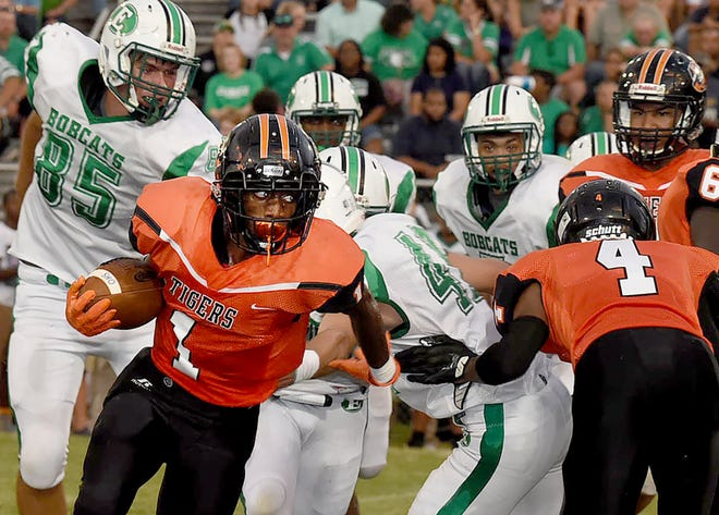 Opelousas High running back Kenny Frazier breaks away from potential Eunice tacklers Friday night during the Tigers' 53-24 loss at Donald Gardner Stadium.