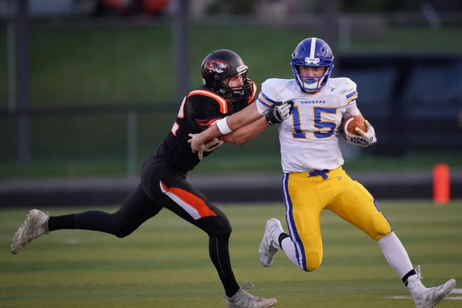 Campbellsport quarterback Nicholas Narges (15) tries to get away from Ethan Greff of Ripon on Friday at Ingalls Field in Ripon.