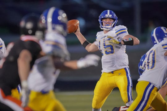 Campbellsport quarterback Nicholas Narges (15) drops back to pass against Ripon.
