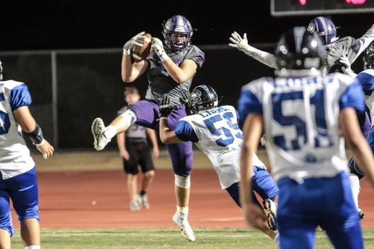 Shadow Hills' Jake Shipley catches the pass for a two-point-conversion in the second quarter against Cathedral City on Friday, August 31, 2018 in Indio.